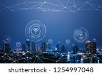 cityscape with connecting dot... | Shutterstock . vector #1254997048