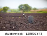 big watering can on the field | Shutterstock . vector #125501645