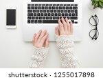 top view of woman's hands... | Shutterstock . vector #1255017898