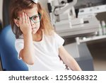 close right eye with your hand. ... | Shutterstock . vector #1255068322
