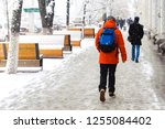 a young man in a red jacket... | Shutterstock . vector #1255084402