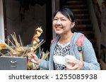 asian woman eating south korea... | Shutterstock . vector #1255085938