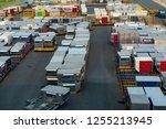 stacking in yard of cargo... | Shutterstock . vector #1255213945