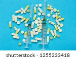 syringes and many pills on a... | Shutterstock . vector #1255233418