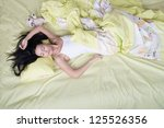 Woman sleeping on her back, view from above - stock photo