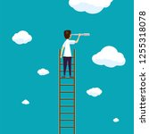 man stands on a ladder in the... | Shutterstock .eps vector #1255318078