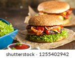 close up of home made burgers... | Shutterstock . vector #1255402942