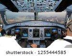 cockpit of passenger airliner... | Shutterstock . vector #1255444585