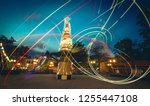 bright neon light trails of... | Shutterstock . vector #1255447108