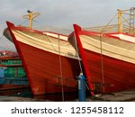 two large wooden boats on the... | Shutterstock . vector #1255458112