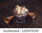 ice cream on brown wooden...   Shutterstock . vector #1255479145