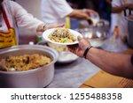 hands of refugees receive... | Shutterstock . vector #1255488358