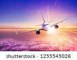 modern airliner flies over the...   Shutterstock . vector #1255545028