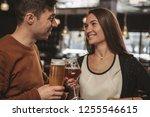 beautiful happy couple looking... | Shutterstock . vector #1255546615
