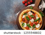 italian pizza with tomatoes ... | Shutterstock . vector #1255548832