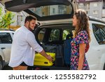 couple put bags in car trunk....   Shutterstock . vector #1255582792