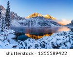 mountains in winter. summit... | Shutterstock . vector #1255589422