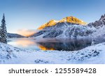 Winter landscape. Winter natural background. Mountains with snow covered hills and sunny peaks by the lake. Tatras, Zakopane, Poland. - stock photo
