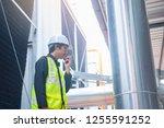 asian maintenance engineer at... | Shutterstock . vector #1255591252