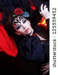 young brunette in black dress... | Shutterstock . vector #125559452