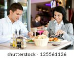 a woman and a man on a business ... | Shutterstock . vector #125561126