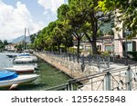 boats moored in lenno  lake... | Shutterstock . vector #1255625848