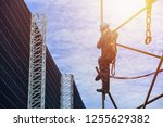 worker on high wear dresses and ... | Shutterstock . vector #1255629382