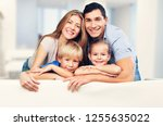 beautiful smiling family... | Shutterstock . vector #1255635022