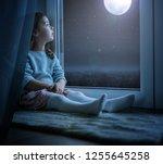 cute little girl in an winter x ...   Shutterstock . vector #1255645258