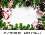 christmas frame from fir tree... | Shutterstock . vector #1255698178