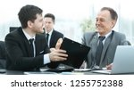 adult businessman discussing... | Shutterstock . vector #1255752388