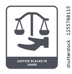 justice scales in hand icon... | Shutterstock .eps vector #1255788115
