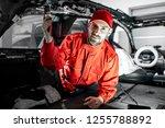 handsome auto service worker in ... | Shutterstock . vector #1255788892
