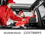 two auto service workers in red ... | Shutterstock . vector #1255788895