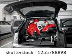 two auto service workers in red ... | Shutterstock . vector #1255788898