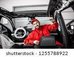 handsome auto service worker in ... | Shutterstock . vector #1255788922