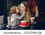 young and pretty mother sitting ... | Shutterstock . vector #1255796158