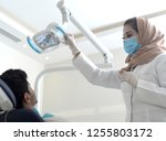 saudi doctor wears a hijab and... | Shutterstock . vector #1255803172