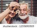 Senior Couple Holding Key...