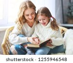happy family mother reads book... | Shutterstock . vector #1255946548