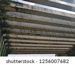 an abandoned structure... | Shutterstock . vector #1256007682