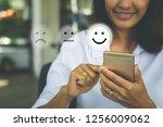 businesswoman pressing face... | Shutterstock . vector #1256009062