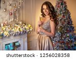 woman at christmas | Shutterstock . vector #1256028358
