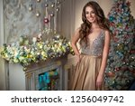 woman at christmas | Shutterstock . vector #1256049742