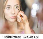 beautiful young woman getting... | Shutterstock . vector #125605172