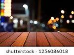 selective empty wooden table in ... | Shutterstock . vector #1256086018