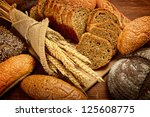 fresh bread  and wheat on the... | Shutterstock . vector #125608775