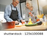 senior couple couple cooking... | Shutterstock . vector #1256100088