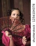girl in retro victorian pink... | Shutterstock . vector #1256104378