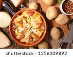 tartiflette  baked potato ... | Shutterstock . vector #1256109892
